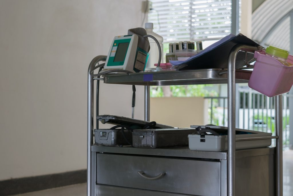 Medical equipment on a stainless steel trolley in a healthcare facility